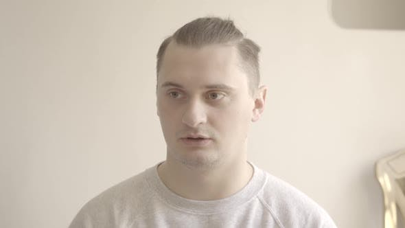 Thumbnail for Portrait of Brunette Brown-eyed Man Talking with Someone and Looking at Camera. Young Caucasian Guy