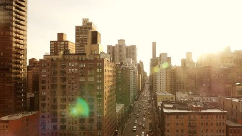 Establishing Shot of Urban Street and Cityscape Landmark Scenery in New York City at Sunset