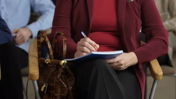 Thumbnail for Closeup Woman's Hands Making Notes During Seminar