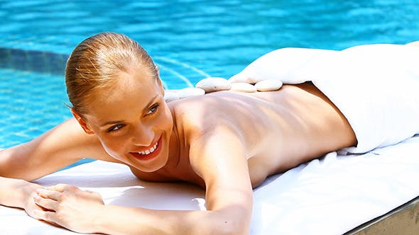 Beautiful Woman Taking Hot Stones Therapy