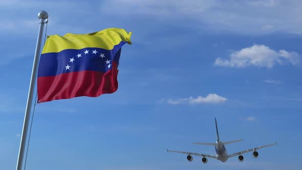 Airplane Landing Behind Flag of Venezuela