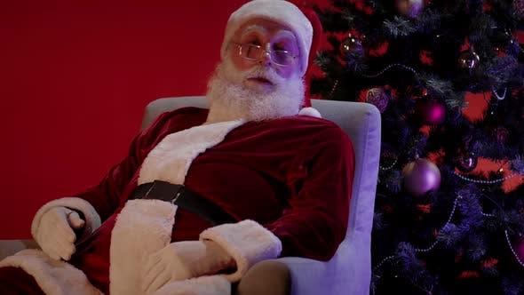 Thumbnail for Santa Claus Sleeping on Armchair near Christmas Tree