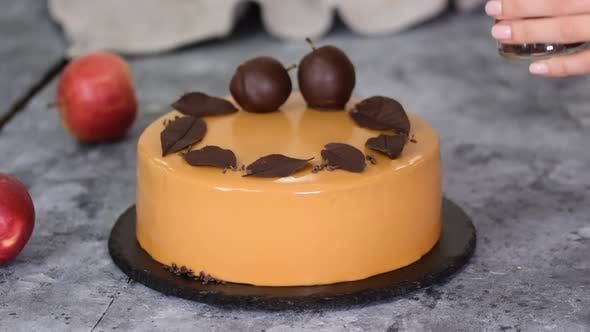 Cover Image for Pastry Chef Decorating the Mousse Cake with Small Chocolate Pieces. Pastry Chef Decorated Modern