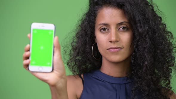 Thumbnail for Young Beautiful Hispanic Businesswoman Showing Phone