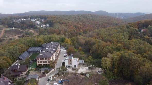 Thumbnail for Drone Flying Over the Apartment Building and Forest