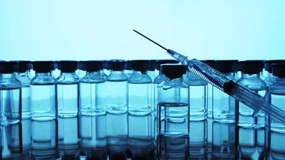 Vaccine bottles and syringe injection. Medicine in ampoules.