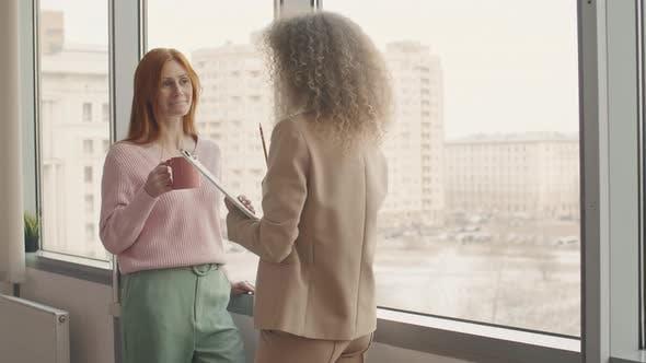 Thumbnail for Businesswomen Having Coffee Break