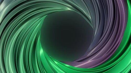 Rotating purple and green torus