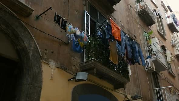 Thumbnail for Dilapidated Residential Complex with Piles of Washed Laundry Drying on Balconies