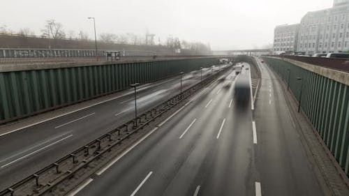 Time lapse of busy city highway, cars moving on a foggy early morning 4k