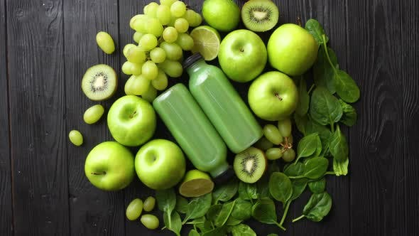 Thumbnail for Mixed Green Fruits and Vegetables Placed on Black Wooden Table