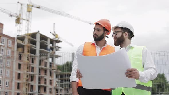 Thumbnail for Male Construction Engineer Discussion with Architect at Construction Site or Building Site of