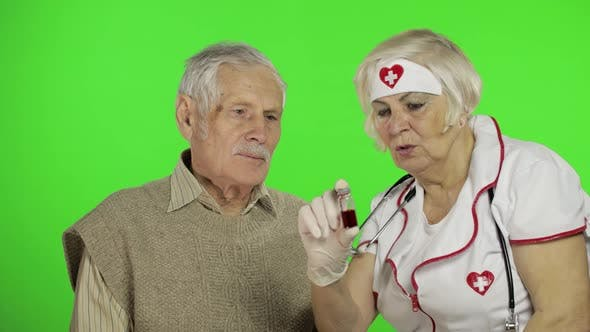 Thumbnail for Mature Woman Nurse Doctor Examines Senior Patient Man with Problems