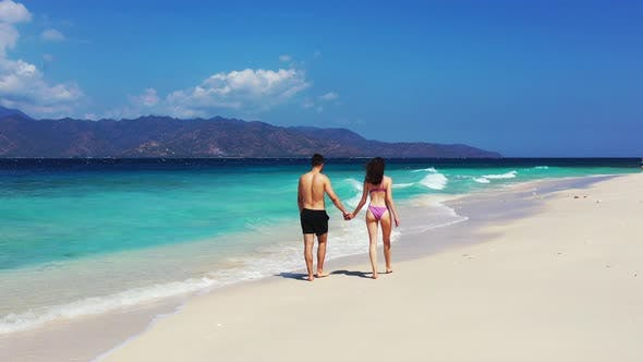 Thumbnail for Romantic Man and Woman Married on Vacation Enjoy Luxury on Beach on Paradise White Sand Background