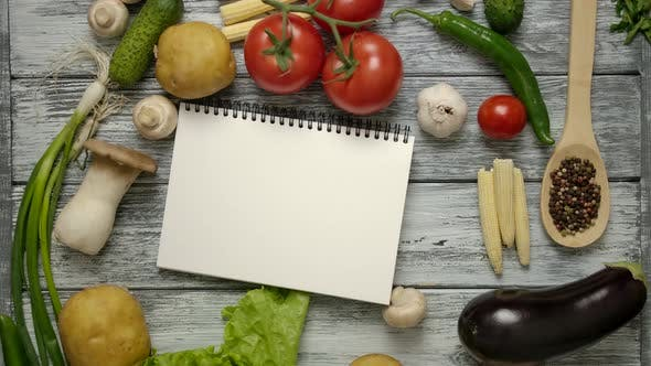 Thumbnail for Cooking Book Throwing on Wooden Table with Recipe Ingredients
