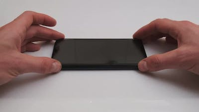Sticking Protective Glass on the Smartphone Screen Change Cracked Safety Glass