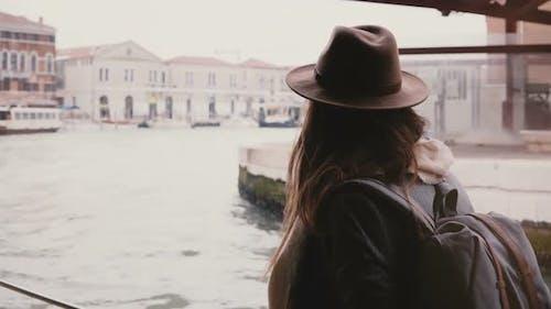 Back View of Young Tourist Woman Enjoying Beautiful Boat Excursion Tour Along Big City River