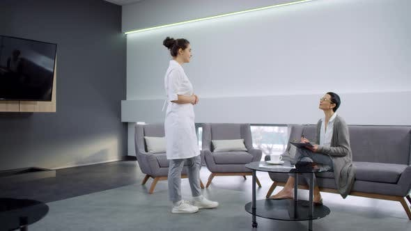 Thumbnail for Female Dentist Asking Patient to Follow Her