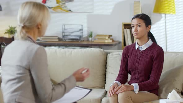 Thumbnail for Young Asian Woman Talking with Female Psychologist