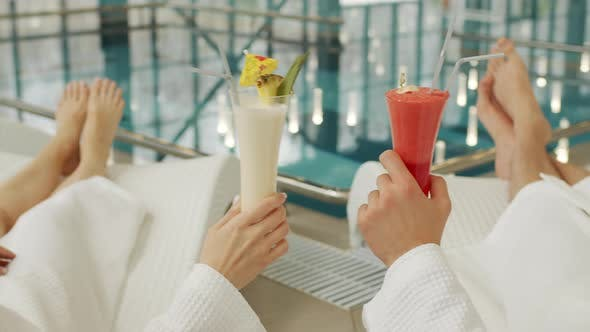 Thumbnail for Couple Clinking Cocktails By Pool