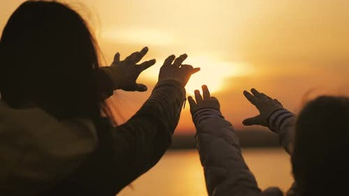 Silhouette of Reaching Helping Hand Hope and Support Each Other Over Sunset