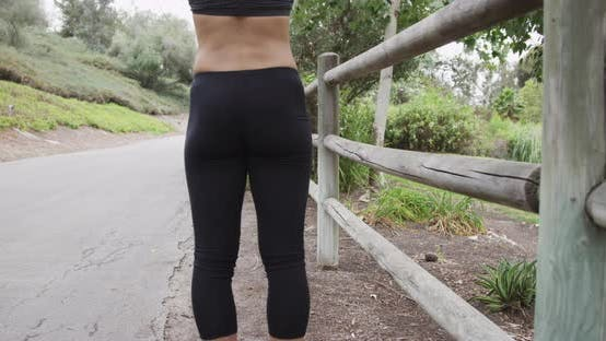 Thumbnail for Healthy athletic Asian woman stretching at the park