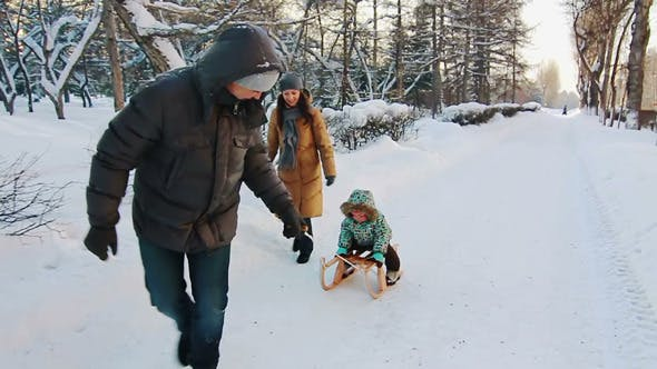 Thumbnail for Father Sledding His Son Along The Road