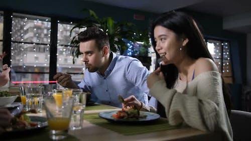 Joyful Mates Enjoying Tasty Food and Conversation