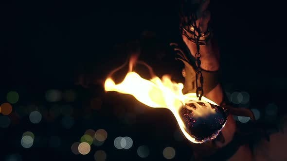 Thumbnail for Close-up Shot of Burning Poi Hanging on Chain.