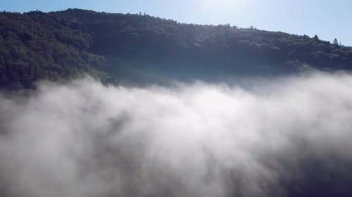 Flight Over the Cloud on Top of the Mountain. A Cloud Formed on Top of a Mountain.