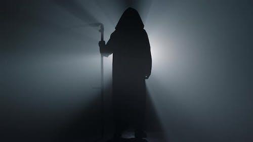 Silhouette Grim Reaper Standing Indoors