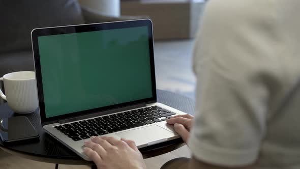 Thumbnail for Businesswoman Looking At Green Screen Of Laptop