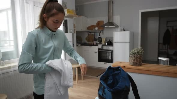 Thumbnail for Sportswoman Packing Backpack at Home