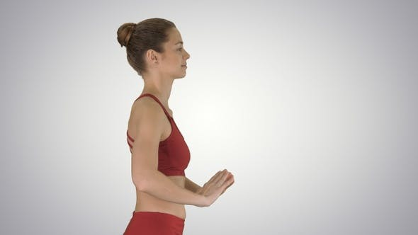 Thumbnail for Happy sporty woman doing yoga breathing exercise while