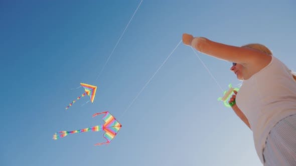 Thumbnail for Active Rest on the Beach - Woman Playing with Kite, Low Angle Shot