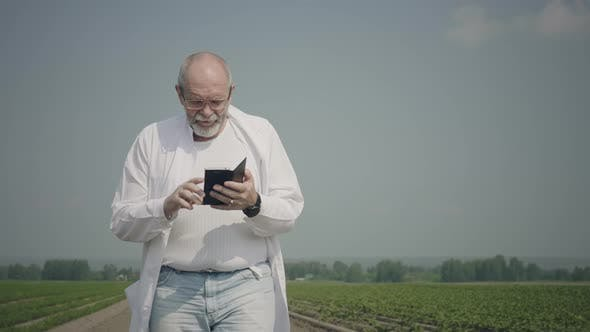 Thumbnail for Scientist using mobile phone in field
