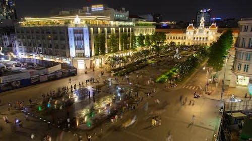 Crowd on Nguyen Hue Pedestrian Street with Statue Ho Chi Minh, Vietnam Timelapse