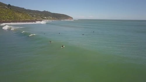 Aerial view of surfers in New Zealand