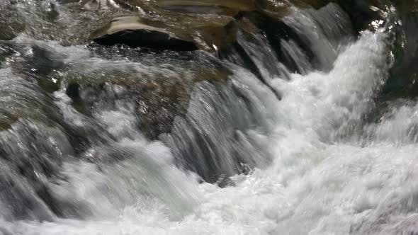 Powerful Flow of Water on the Stones
