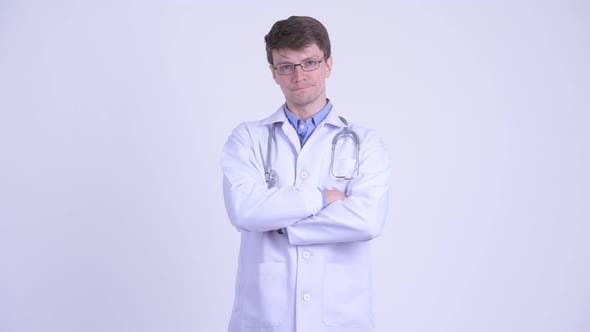Thumbnail for Happy Young Handsome Man Doctor Smiling with Arms Crossed