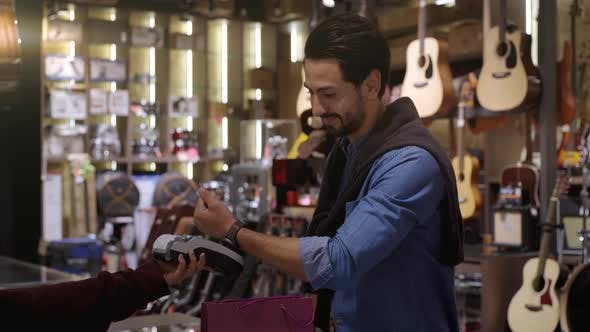 Thumbnail for A Middle Eastern Man Using Smartwatch To Purchase Product