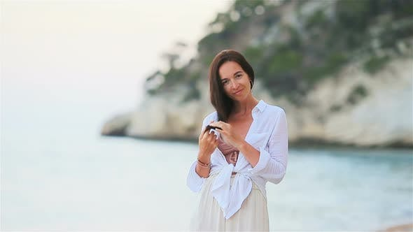 Thumbnail for Young Beautiful Woman on White Tropical Beach