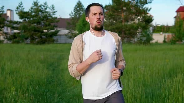 Thumbnail for Jogging in the Morning. Male Runner in Sportswear Doing Morning Jogging