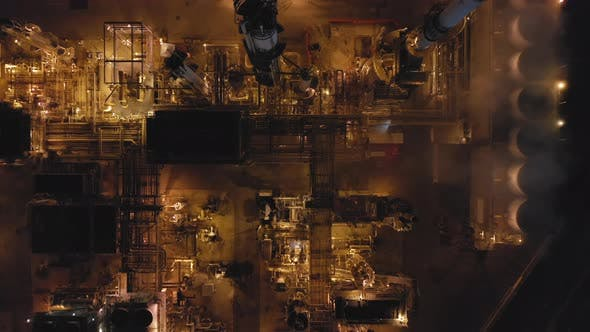Thumbnail for Aerial Topdown Footage Over the Territory of Modern Petroleum Refinery at Night.