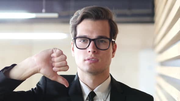 Thumbnail for Thumbs Down Gesture by Man in Suit, Portrait