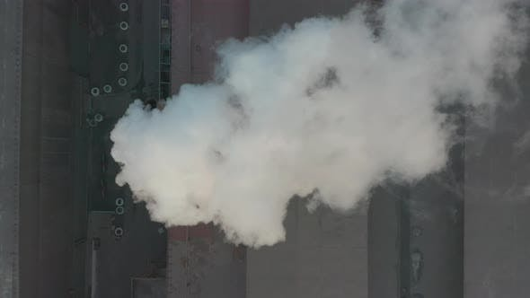 Thumbnail for Aerial View. Industrial Zone with Pipe Thick White Smoke Is Poured From the Factory Pipe in Contrast