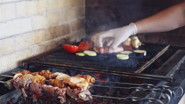 Grilled meat skewers. Meat preparing on barbecue grill over charcoal
