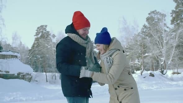 Thumbnail for Man Ice Skating with Girlfriend