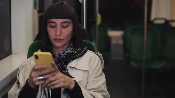 Thumbnail for Young Hipster Woman Using Smartphone Sitting in Public Transport, Steadicam Shot. Young Woman