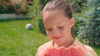 Cute Girl With Watermelon Outdoors